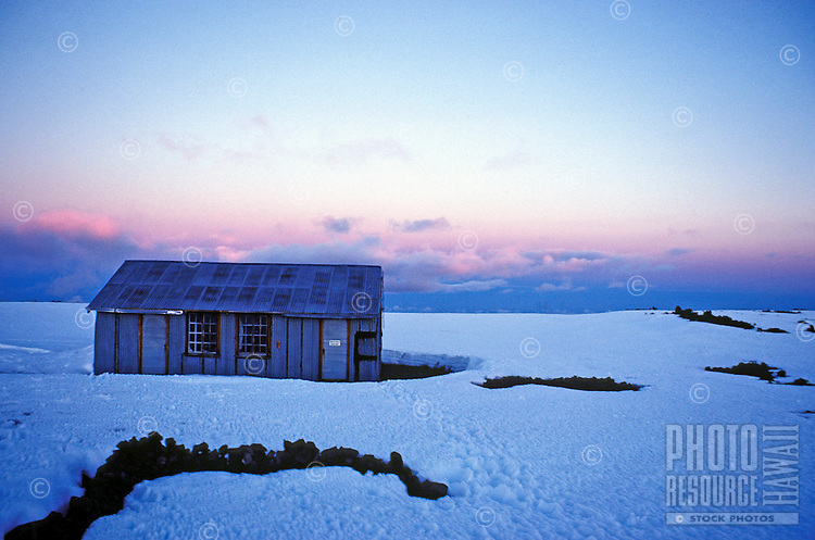 Cabin amidst snow on Mauna Loa, which is in the Volcanoes National Park on the Big Island of Hawaii