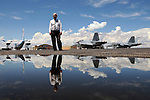 pvc080411d/8-4-11/asec.  Lowell Whitten (CQ), Vice President/General Manager of Cutter Aviation Albuquerque, stands on the ramp (Or apron) at Cutter that was slated to be replaced before the FAA funding delay, photographed Thursday Aug. 4, 2011.  The standing water in the foreground is caused by a low spot near a storm drain.  (Pat Vasquez-Cunningham/Journal)