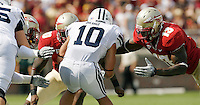 TALLAHASSEE, FL 9/18/10-FSU-BYU FB10 CH-Florida State's Brandon Jenkins, left, Nick Moody and Nigel Bradham try to pen down Brigham Young's JJ Di Luigi  during first half action Saturday at Doak Campbell Stadium in Tallahassee. .COLIN HACKLEY PHOTO