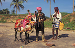 Musicians with their cow on the beach at Anjuna in Goa in India.