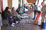 Native American artisans display hand-made wares in front of the Palace of the Governors in Santa Fe, New Mexico