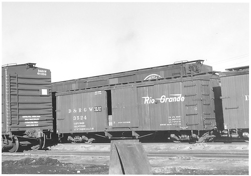 Box car #3524 in yard with standard gauge wood and steel box cars.<br /> D&amp;RGW  Alamosa, CO  Taken by Richardson, Robert W. - 1/1949