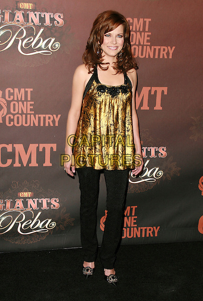 MARTINA McBRIDE.At CMT Giants honoring Reba McEntire held at the Kodak Theatre, Hollywood, LA, California, USA.26 October 2006..full length gold top dress over black trousers.Ref: ADM/CH.www.capitalpictures.com.sales@capitalpictures.com.©Charles Harris/AdMedia/Capital Pictures.