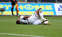 5th July 2020; Liberty Stadium, Swansea, Glamorgan, Wales; English Football League Championship, Swansea City versus Sheffield Wednesday; Rhian Brewster of Swansea City goes down injured holding his shoulder late in the second half