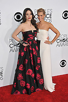 Kat Dennings & Beth Behrs (right) at the 2014 People's Choice Awards at the Nokia Theatre, LA Live.<br /> January 8, 2014  Los Angeles, CA<br /> Picture: Paul Smith / Featureflash