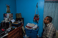 Carlos Saldana looks at a small shrine created in memory of his and Vicky Delgadillio's missing children in the bedroom of their home in Xalapa, Mexico on November 4, 2017. <br /> Photo Daniel Berehulak for The New York Times
