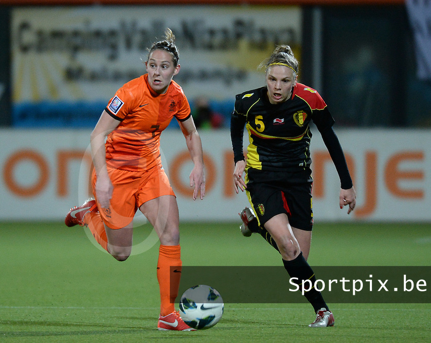 20140212 - ZWOLLE , THE NETHERLANDS : Dutch Manon Melis (l)  pictured with Belgian Lorca Van De Putte (r) during the female soccer match between The Netherlands and Belgium , on the fifth matchday in group 5 of the UEFA qualifying round to the FIFA Women World Cup in Canada 2015 at Het Ijseldelta Stadion , Zwolle . Wednesday 12th February 2014 . PHOTO DAVID CATRY