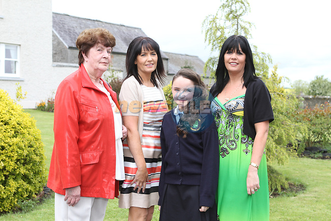 Kelsey Smith from Duleek Girls NS with Kathleen O'Hare, Veronica Smith and Myra McCormick at the Confirmation in Duleek Church...(Photo Jenny Matthews/www.newsfile.ie)