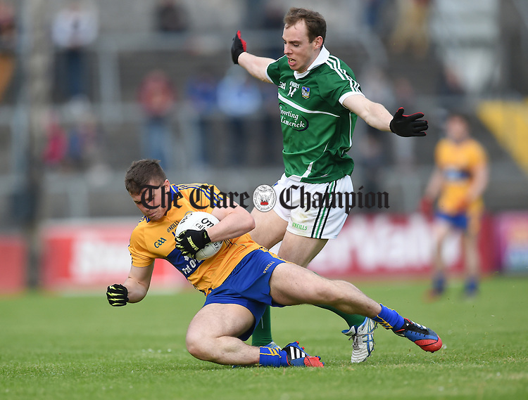 Sean Collins of Clare in action against Seanie Buckley of Limerick during their Championship game in Ennis. Photograph by John Kelly.
