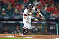 Jake Mangum (15) of the Mississippi State Bulldogs is hit in the thigh by the baseball after laying down a bunt against the Houston Cougars in game six of the 2018 Shriners Hospitals for Children College Classic at Minute Maid Park on March 3, 2018 in Houston, Texas. The Bulldogs defeated the Cougars 3-2 in 12 innings. (Brian Westerholt/Four Seam Images)