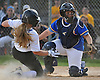 Julianna Budriss #16, West Islip catcher, right, tries to corral a throw to the plate as Cara Quinn #1 of North Babylon slides home safely in the bottom of the fourth inning of a Suffolk County League V varsity softball game at North Babylon High School on Wednesday, May 9, 2018. North Babylon won by a score of 4-1.