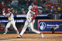 Casey Opitz (12) of the Arkansas Razorbacks makes contact with the baseball during the game against the Baylor Bears in game nine of the 2020 Shriners Hospitals for Children College Classic at Minute Maid Park on March 1, 2020 in Houston, Texas. The Bears defeated the Razorbacks 3-2. (Brian Westerholt/Four Seam Images)