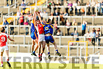 John Spillane and Peter O'Shea Kenmare in action against Brendan O'Keeffe Rathmore in the Senior County Football Semi Final in Fitzgerald Stadium on Sunday.