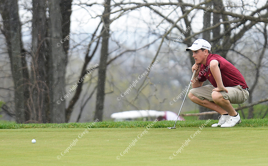 Madison Edgewood's Johnny Decker sets up to putt during the Morgan Stanley Shootout on Thursday, May 8, 2014, at University Ridge Golf Course in Madison, Wisconsin
