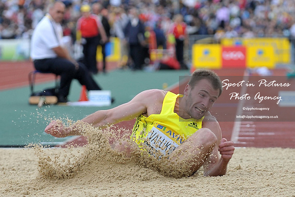 Dmitrij Valukevic (Slovakia) lands in the sand. Mens Triple Jump. Aviva London Grand Prix. Crystal Palace. London. 24/07/2009. Credit Sport in Pictures/Garry Bowden