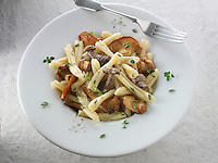 Wiild  chanterelle or girolle (Cantharellus cibarius), Pied de Mouton Mushrooms (hydnum repandum) or hedgehog mushrooms, Pied Bleu of blue foot mushrooms (Clitocybe nuda) with Casarecce Pasta