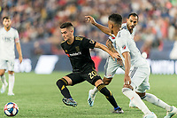 FOXBOROUGH, MA - AUGUST 4: Eduard Atuesta #20 of Los Angeles FC dribbles during a game between Los Angeles FC and New England Revolution at Gillette Stadium on August 3, 2019 in Foxborough, Massachusetts.