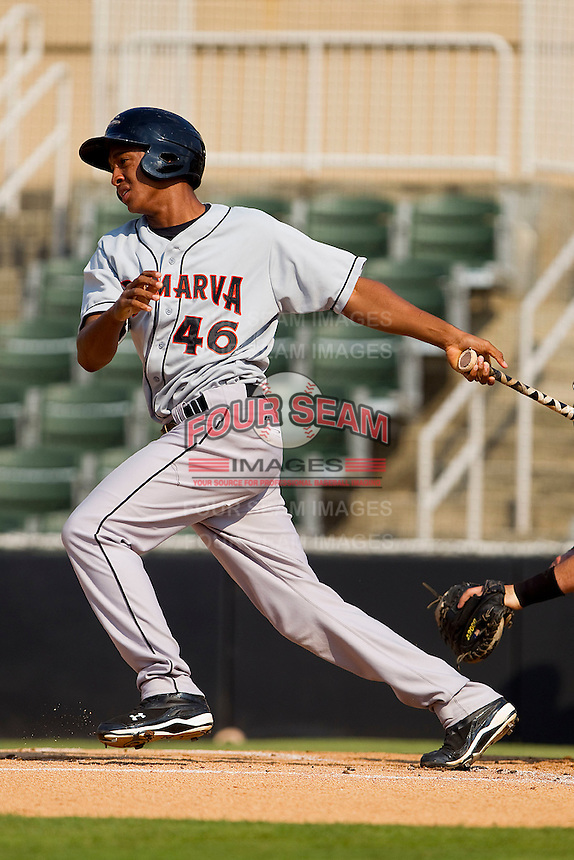 Jonathan Schoop #46 of the Delmarva Shorebirds follows through on his swing against the Kannapolis Intimidators at Fieldcrest Cannon Stadium on May 22, 2011 in Kannapolis, North Carolina.   Photo by Brian Westerholt / Four Seam Images
