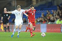 Riku Riski of Finland attempts to hold back Gareth Bale of Wales during the Wales v Finland Vauxhall International friendly football match at the Cardiff City stadium, Cardiff, Wales. Photographer - Jeff Thomas Photography. Mob 07837 386244. All use of pictures are chargeable.