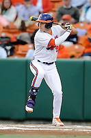 Clemson Tigers  right fielder Steven Duggar #9 swings at a pitch during a game against the Virginia Cavaliers  at Doug Kingsmore Stadium on March 15, 2013 in Clemson, South Carolina. The Cavaliers won 6-5.(Tony Farlow/Four Seam Images).