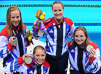PICTURE BY ALEX BROADWAY /SWPIX.COM - 2012 London Paralympic Games - Day Nine - Swimming, Aquatic Centre, Olympic Park, London, England - 07/09/12 - Louise Watkin, Stephanie Millward, Claire Cashmore & Heather Frederiksen of Great Britain pose with their Silver Medals after the Women's 4x100m Individual Medley 34 Points Relay Final.