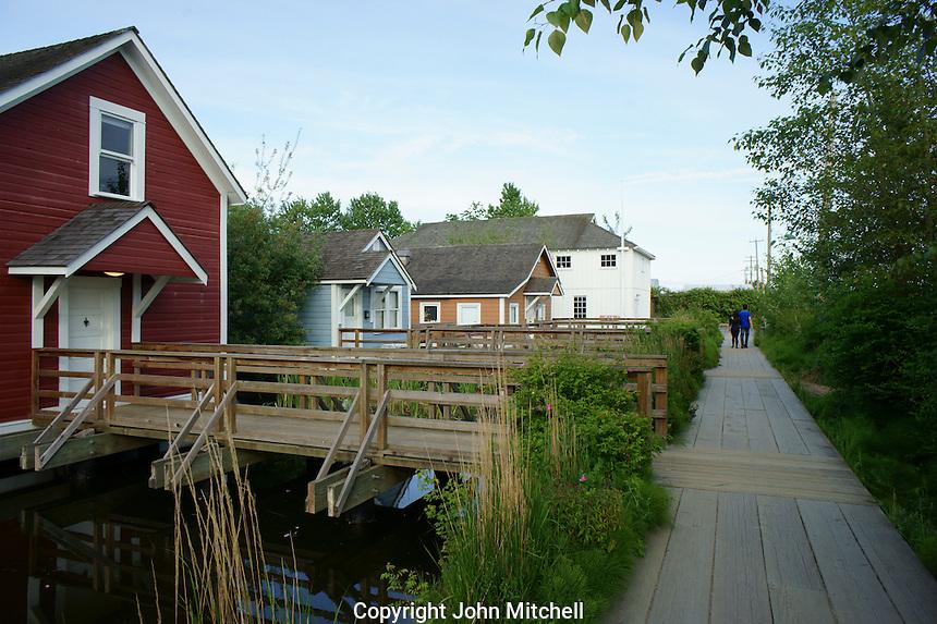 Restored workers' houses and boardwalk in  the Britannia Heritage Shipyard park, Steveston, British Columbia, Canada