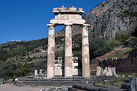 DELPHI, GREECE - APRIL 11 : A front view of the Tholos, on April 11, 2007 in the Sanctuary of Athena Pronaia, Delphi, Greece. Circular marble structure, the Tholos is in the Doric order and was built at the beginning of the 4th century BC. Only 3 of the 20 columns that were surrounding the cella walls have been restored with the epistyle, triglyphs, metopes and part of the gutter of the roof. (Photo by Manuel Cohen)