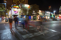Austinites walk the streets in the downtown 6th Street Entertainment district where there are hundreds of bars and restaurants to choose from in Austin, Texas.