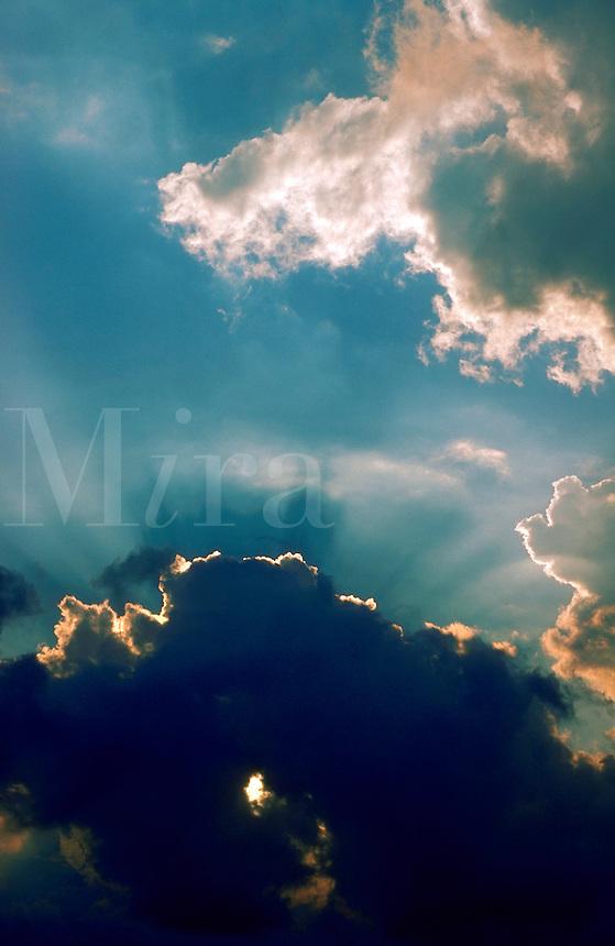 Sunrays through clouds.