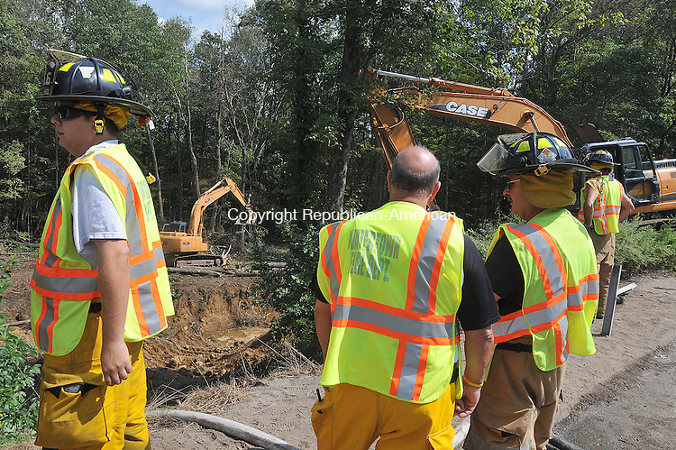 LITCHFIELD, CT, 13 SEPTEMBER 2011-011311JS02--Members of the Watertown Fire Department were on the scene as environmental crews remove contaminated soil off of Route 8 in Thomaston on Tuesday a day after tanker accident near exit 39, dumped 5,700 gallons of gasoline into the soil.  <br /> Jim Shannon Republican-American