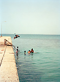 ERITREA, Assab, boys swim in the Red Sea near the Ras Gembo Hotel