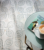 Heathrow Grande, a hand-cut and waterjet mosaic, shown in honed Cloud Nine and tumbled Ming Green, is a design by Paul Schatz and is part of the Palazzo™ collection by New Ravenna.