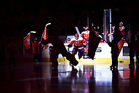 WASHINGTON, DC - MARCH 26: Washington Capitals left wing Alex Ovechkin (8) skates onto the ice before the game while spot lit behind Washington Capitals goalie Braden Holtby (70) before the Carolina Hurricanes vs. Washington Capitals NHL game March 26, 2019 at Capital One Arena in Washington, D.C.. (Photo by Randy Litzinger/Icon Sportswire)