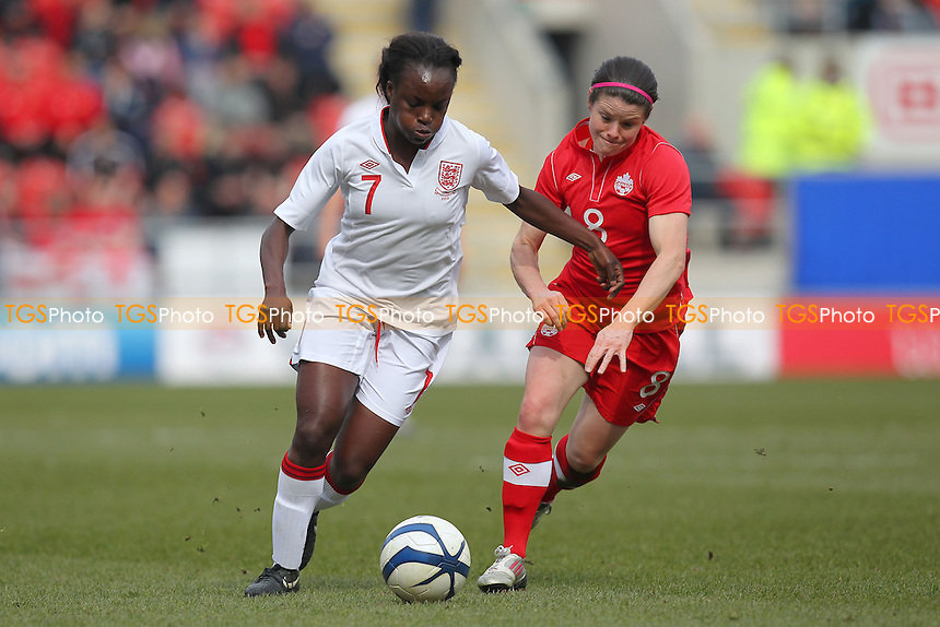 Eniola Aluko of England and Diana Matheson of Canada - England Women vs Canada Women - International Football Friendly Match at the New York Stadium, Rotherham United FC - 07/04/13 - MANDATORY CREDIT: Gavin Ellis/TGSPHOTO - Self billing applies where appropriate - 0845 094 6026 - contact@tgsphoto.co.uk - NO UNPAID USE.