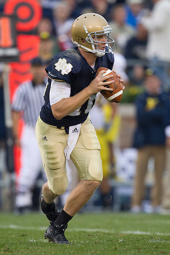 Notre Dame quarterback Nate Montana (#16) rolls out to pass the ball during NCAA football game between the Notre Dame Fighting Irish and the Michigan Wolverines.  Michigan defeated Notre Dame 28-24 in game at Notre Dame Stadium in South Bend, Indiana.