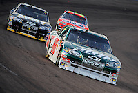 Nov. 9, 2008; Avondale, AZ, USA; NASCAR Sprint Cup Series driver Dale Earnhardt Jr leads Mark Martin and Jeff Gordon during the Checker Auto Parts 500 at Phoenix International Raceway. Mandatory Credit: Mark J. Rebilas-