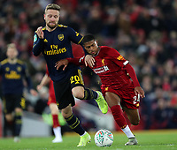 30th October 2019; Anfield, Liverpool, Merseyside, England; English Football League Cup, Carabao Cup, Liverpool versus Arsenal; Rhian Brewster of Liverpool takes on Shkodran Mustafi of Arsenal - Strictly Editorial Use Only. No use with unauthorized audio, video, data, fixture lists, club/league logos or 'live' services. Online in-match use limited to 120 images, no video emulation. No use in betting, games or single club/league/player publications