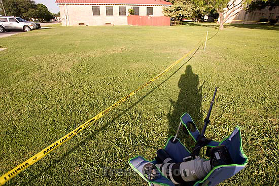 Eldorado - at the Schleicher County Courthouse Tuesday, July 22, 2008, where a grand jury met to hear evidence of possible crimes involving FLDS church members from the YFZ ranch.  trent shadow with cameras and chair and yellow tape