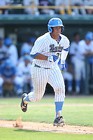 Darrell Miller Jr (31) of the UCLA Bruins runs to first base during a game against the Arizona Wildcats at Jackie Robinson Stadium on May 16, 2015 in Los Angeles, California. UCLA defeated Arizona, 6-0. (Larry Goren/Four Seam Images)