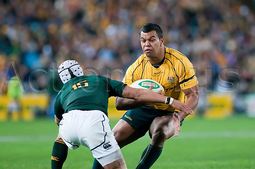 23.07.2011 Rugby Union Australian Wallabies 39 v South Africa Springboks 20,Tri Nations, at the ANZ Stadium in Sydney- Kurtley Beale triies to evade Gio Aplon