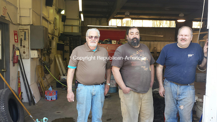 WATERTOWN, CT 01 May 2014-050114LW02 - From left, O'Neil St-Onge, Rich Derouin and Rick St-Onge stand outside Neil's Auto Body on Main Street in Watertown. The auto body shop closed Wednesday after 47 years in business.<br />