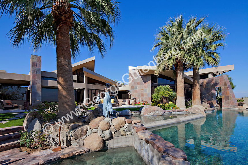 daytime view of lush outdoor living spaces and pool area of ultra modern luxury home - Ultra Modern Luxury Homes