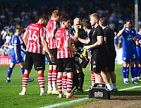 Lincoln City players take a water break towards the end of the game<br /> <br /> Photographer Andrew Vaughan/CameraSport<br /> <br /> The EFL Sky Bet League Two - Lincoln City v Tranmere Rovers - Monday 22nd April 2019 - Sincil Bank - Lincoln<br /> <br /> World Copyright © 2019 CameraSport. All rights reserved. 43 Linden Ave. Countesthorpe. Leicester. England. LE8 5PG - Tel: +44 (0) 116 277 4147 - admin@camerasport.com - www.camerasport.com