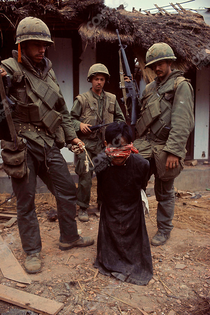 U.S. Marines with a captured civilian, suspected of being a North Vietnamese sympathiser, Tet offensive, Battle of Hue, Vietnam, February 1968
