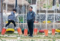 There's fun to be had at the large playground (which mostly seems geared toward adults) at the Sanmenxia pit yards.