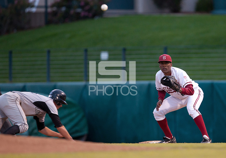 STANFORD, CA - March 25, 2011: Brian Ragira of Stanford baseball prepares to catch a pickoff attempt by Mark Appel during Stanford's game against Long Beach State at Sunken Diamond. Stanford lost 6-3.