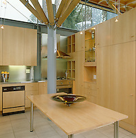 The purpose-built kitchen is designed with units of maple wood and stainless steel work surfaces