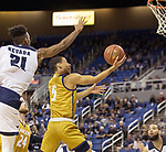 California Baptist guard Jeremy Smith (5) shoots a lay-up as Nevada's forward Jordan Brown (21) defends in the second half of an NCAA college basketball game in Reno, Nev., Monday, Nov. 19, 2018. (AP Photo/Tom R. Smedes)
