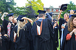 Graduates in gowns holding their mortarboards, Goldsmiths, University of London, England, UK