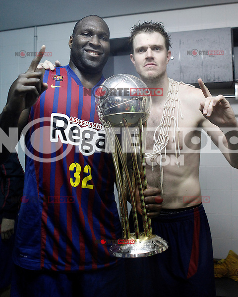 FC Barcelona Regal's Nathan Jawai (l) and CJ Wallace celebrate the victory in the Spanish Basketball King's Cup Final match.February 07,2013. (ALTERPHOTOS/Acero)